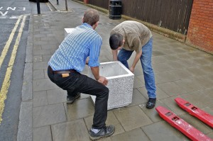 Planters are moved into place. Each one weighs 180kg, even without the soil.